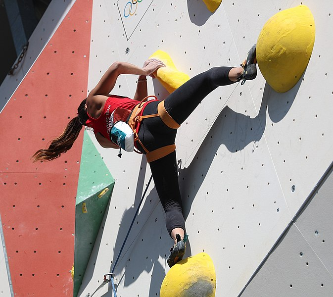 Woman on a climbing wall