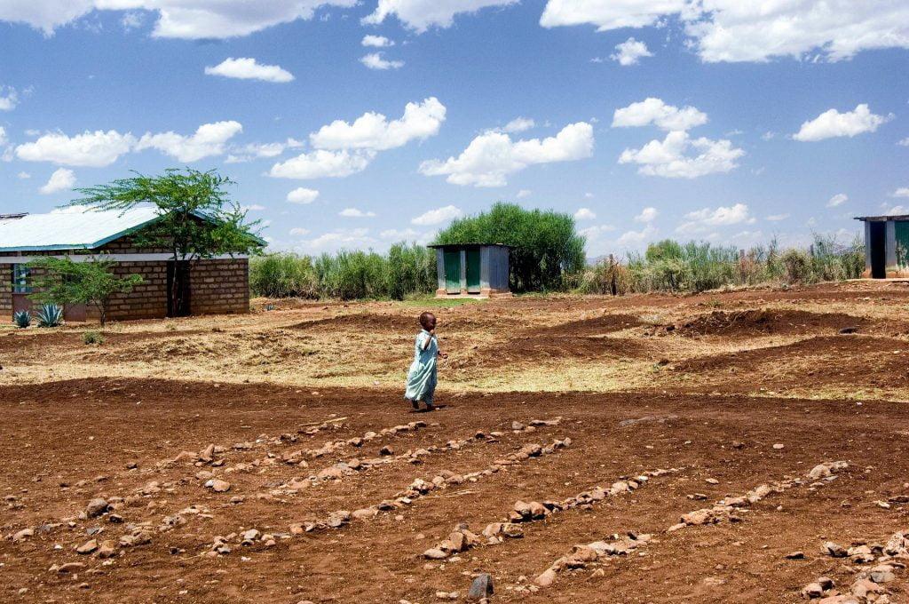 A girl in Kenya on an empty field