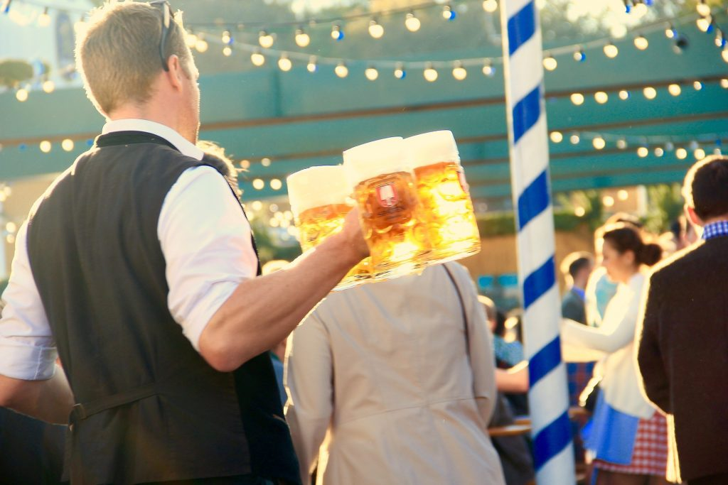 A waiter serves beer at Oktoberfest