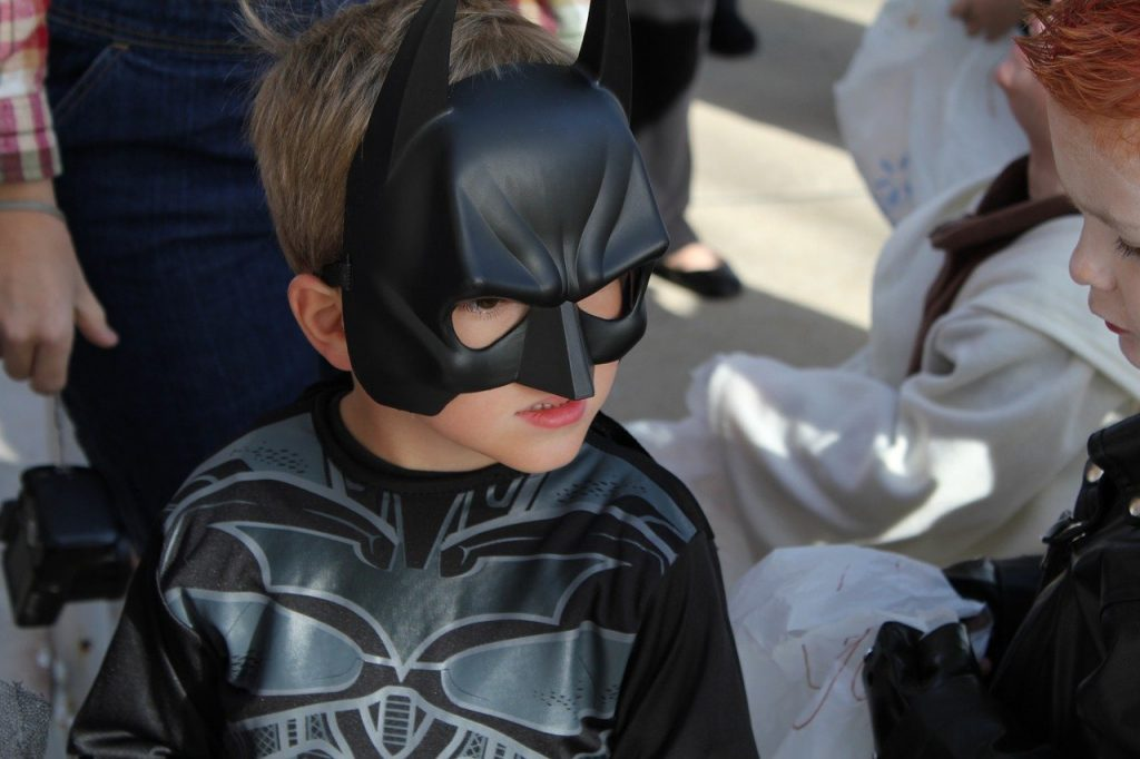 a child dressed as batman