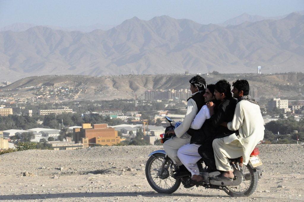 Teens riding a motorbike