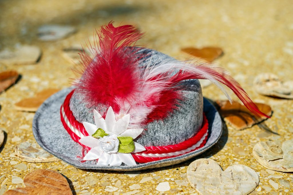 a gray hat with feathers