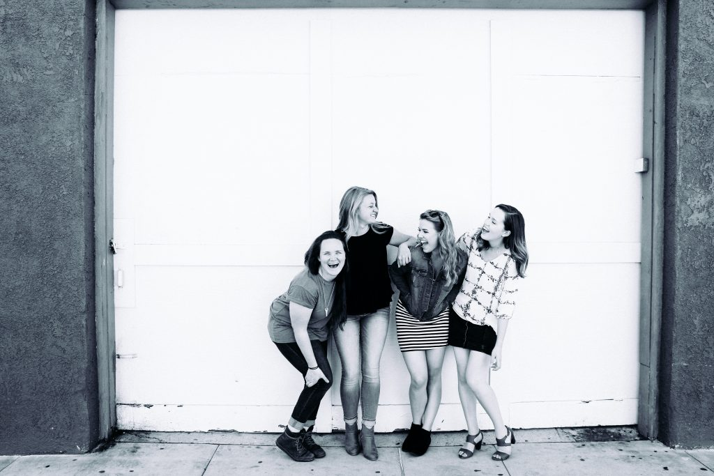 A group of young women laughing