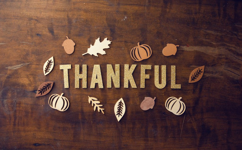 "Text on a brown background that says ""Thankful"""