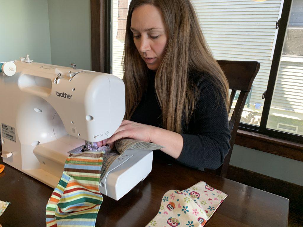 Liz sews masks at home