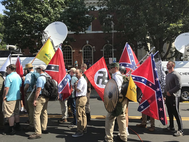 Alt-right members carry Nazi and Confederate Flags in Charlottesville hate rally