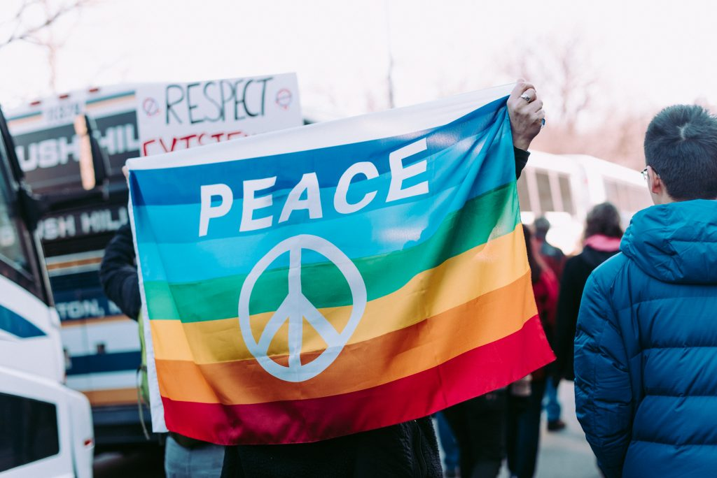"a flag with ""peace"" written on it"