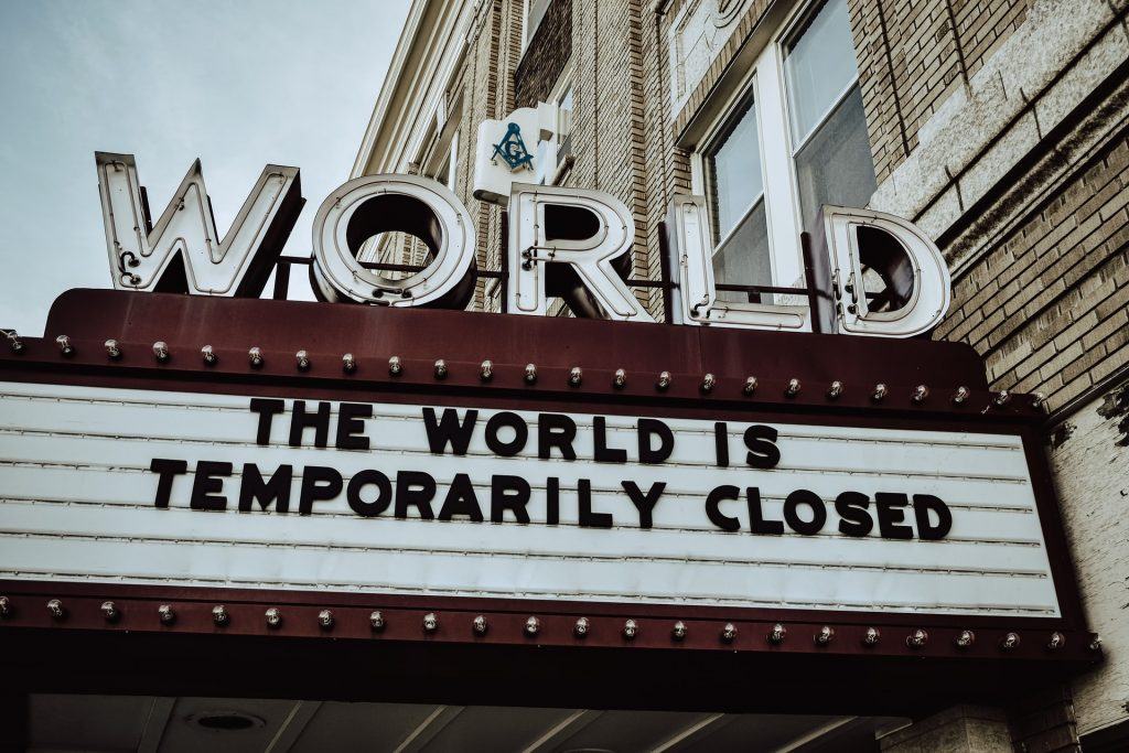 A sign saying the world is closed for a time;