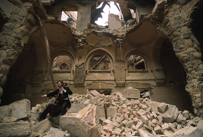 Vedran Smailović plays in the partially destroyed National Library in Sarajevo, 1992